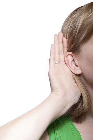 tattle: young blond woman listening to gossip isolated on white