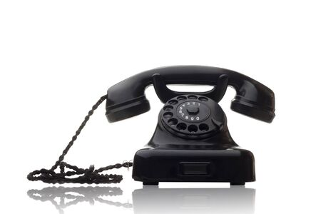 old vintage black rotary telephone isolated on white Stock Photo - 5273865