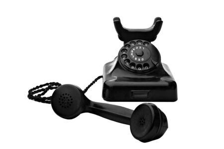 old vintage black rotary telephone isolated on white Stock Photo - 5273868