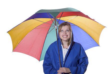 young smiling women in a blue rain coat holding multicolored umbrella Stock Photo - 5364815