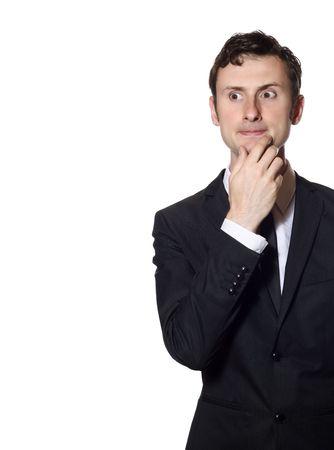 business skeptical: empresario incierto en un traje negro aislado sobre blanco con un mont�n de copia-spyce Foto de archivo