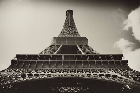 intentional: Sepia antique plate picture of the Eiffel Tower in Paris The vignetting and the grainy toned sepia are intentional