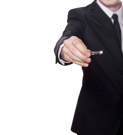 businessman in a black suit has the key to success,with a lot of copy space photo