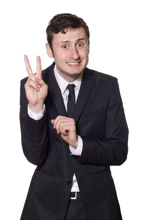 intimidated businessman in a black suit is showing the peace sign