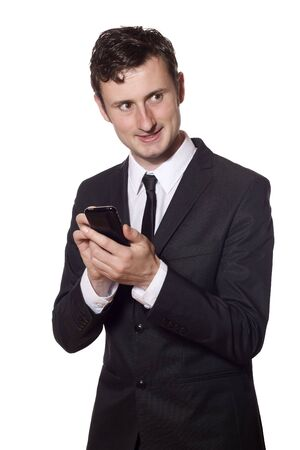businessman in a black suit twitters with a smartphone photo