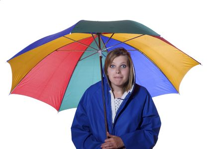 pessimistic: young women in a blue rain coat is looking pessimistic upwards