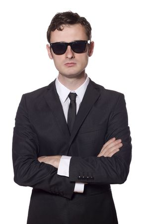 bodyguard with glasses and folded arms, isolated on white Stock Photo
