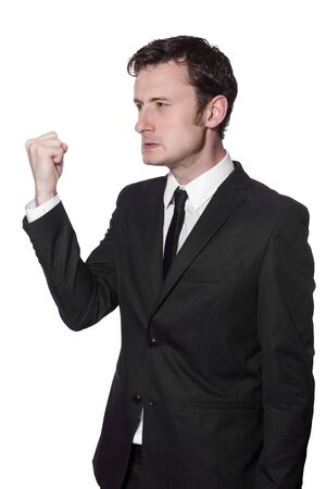 businessman is angry and showing his fist photo