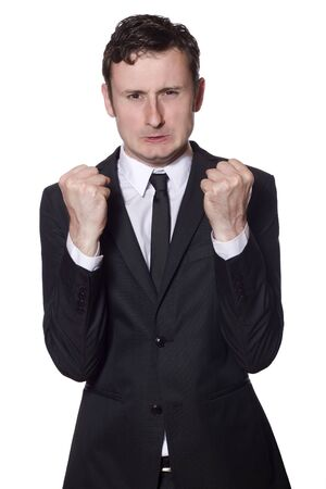 businessman is angry and showing his fists photo