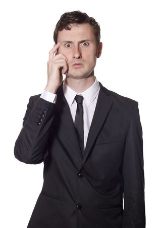 baffled: baffled businessman in a black suit scratching his head