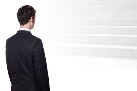 businessman in a black suit looking at stairs Stock Photo - 5781208