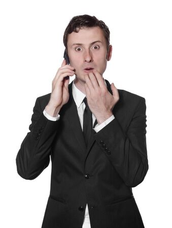 surprised businessman in a black suit with a mobile phone photo