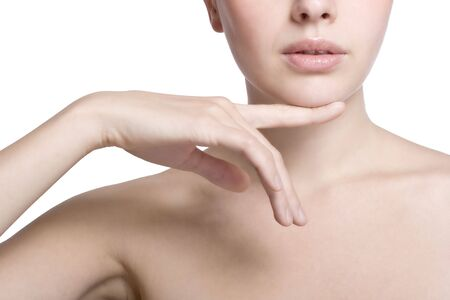 Portrait of young adult woman touching with her hand the healthy skin Stock Photo