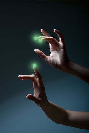 fingers pressing a touchscreen and green spots appear photo