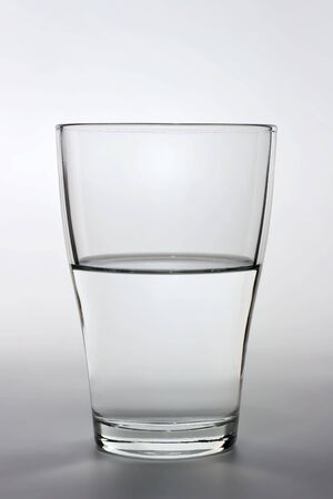 halves: product shot of an half full water glass Stock Photo