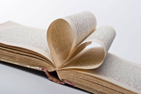 Pages of an old book folded in to a heart shape photo