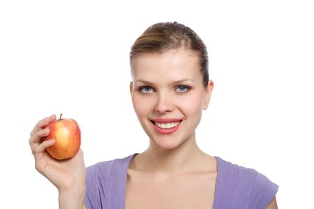 beautiful young blonde woman with a red apple Stock Photo - 6409874