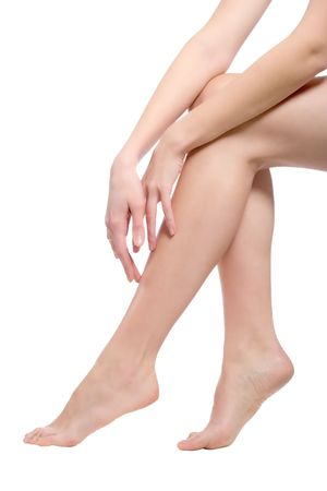 beautiful naked woman legs, isolated over white