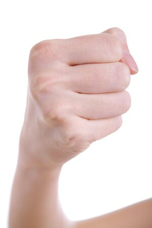 Female hand with fist against a white background photo