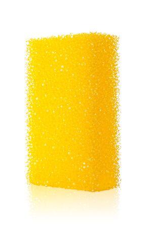 yellow sponge isolated on  white background, with shallow DOF photo
