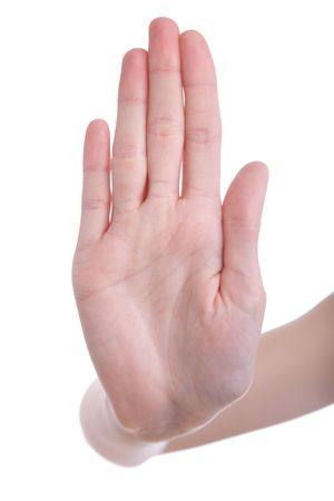 slowdown: Female hand signaling stop against a white background Stock Photo