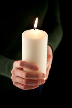 dof: female hands holding a white candle, shallow DOF, Focus on the Flame