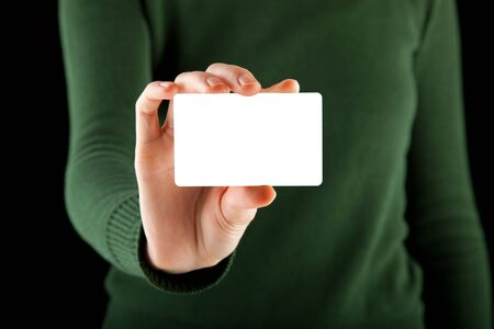 female hand holds a blank card - a business card, a gift card, or even a credit card - just to name a few different options Stock Photo - 6644085