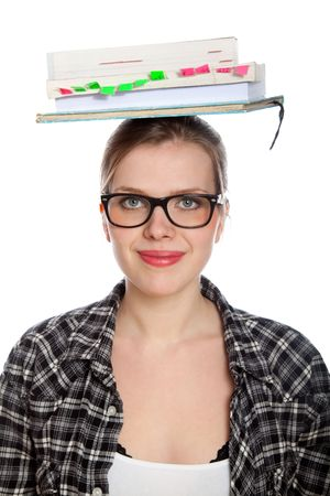 poise: beautiful blonde student girl balancing some books on her head, isolated on white