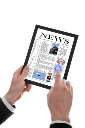 latest news: a male hand holding a touchpad pc showing a newspaper, isolated on white