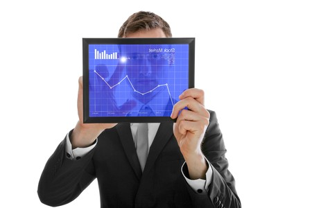 Businessman holding a touchpad pc, one finger touches the screen and checking the stock market, isolated on white photo