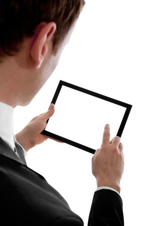 Businessman holding a blank touchpad pc, one finger touches the screen, isolated on white