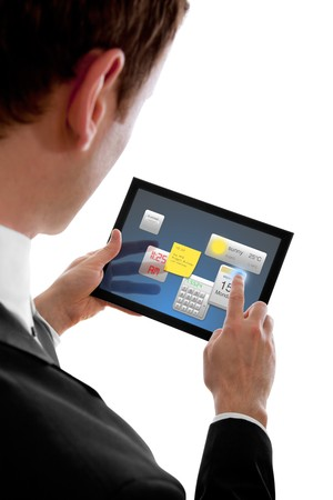 programmes: businessman holding a touchpad pc, using little programmes, isolated on white