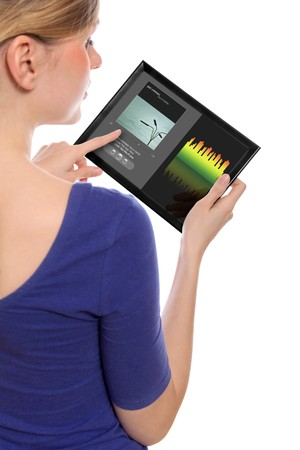 programme: woman holding a touchpad pc, using the music programme, isolated on white