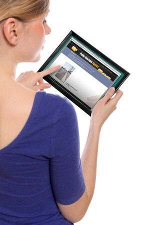 woman holding a touchpad pc, one finger touches the screen and surfing the web Stock Photo