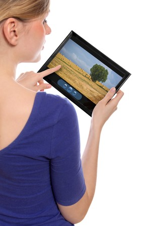 woman holding a touchpad pc showing a movie, isolated on white Stock Photo