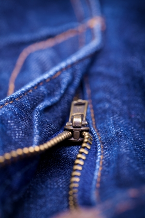 Macro Detail of a blue jeans zipper with a shallow DOF