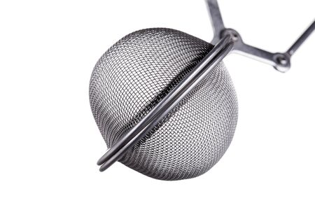 macro shot of a tea infuser, isolated on white background Stock Photo - 17475656