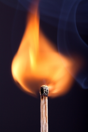 Ignition of a match, with smoke on dark background Stock Photo - 17475660