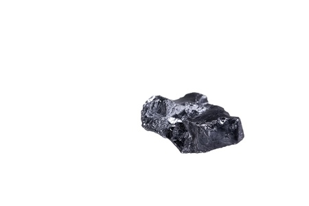 anthracite coal: piece of a small Anthracite coal, isolated on white with a shallow depth of field