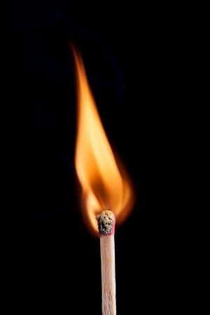 Ignition of a match, with smoke on dark background Stock Photo - 17696566