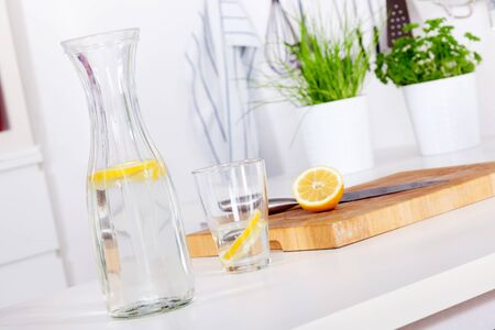 kitchen counter: glass and carafe with refreshing lemonade on a kitchen counter