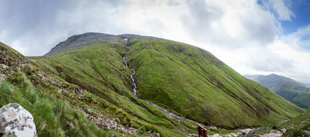 scotish: Panoramic view of the Ben Nevis, the highest Mounatin in the Scotish Highlands, with the Steall Waterfall