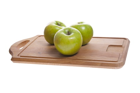 apples on cutting board photo