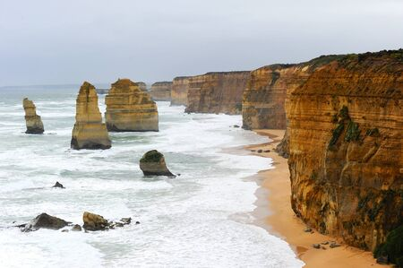 The coastline with the wild ocean of the Twelve Apostles or Port Campbell National  Park  is the highlight on the Great Ocean Road, Victoria, Australia. photo