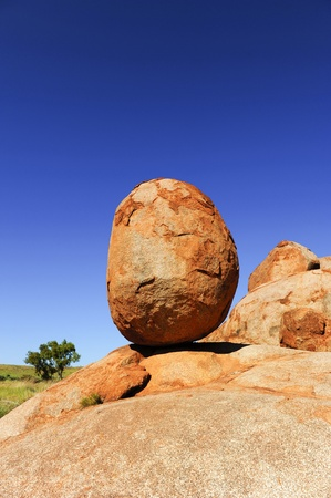 One of the iconic rocks of the Devils Marbles in remote outback of Northern Territory, Australia, a favourite destination for tourists and travelers. photo