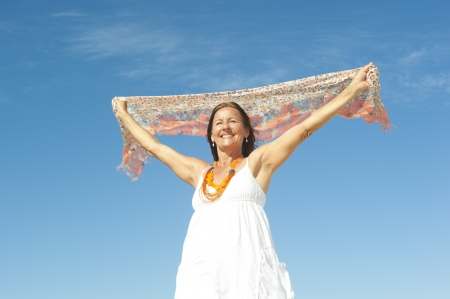 Happy attractive middle aged woman smiling cheerful in winner pose, enjoying active retirement and freedom Stock Photo - 16707750