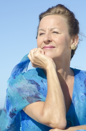 Portrait elegant middle aged woman sunny day outdoor, isolated happy smiling with blue sky as background. Stock Photo - 16948839