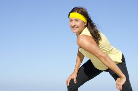determined: Portrait fit and healthy, confident and determined attractive looking mature woman exercising