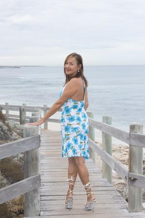 A very beautiful mature lady posing