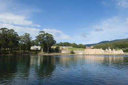 penal: Site of former Penal Convict Settlement Port Arthur on Tasmania, Australia, with ruin of prison at water of harbour and other old buildings.